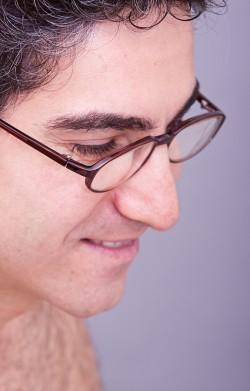 Man in eyeglasses smiling