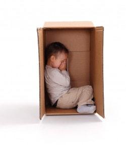 bigstock-Sad-Little-Boy-Hiding-In-Cardb-25863794